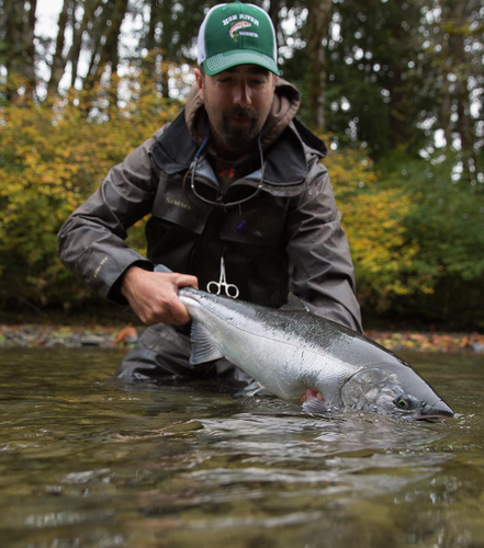 Jim Kerr holding Washington river steelhead